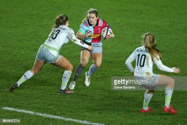 Rachael Burford of Harlequins Ladies takes on Cara Wardle of Saracens Women during the Tyrrells Premier 15s match between Harlequins Ladies and...