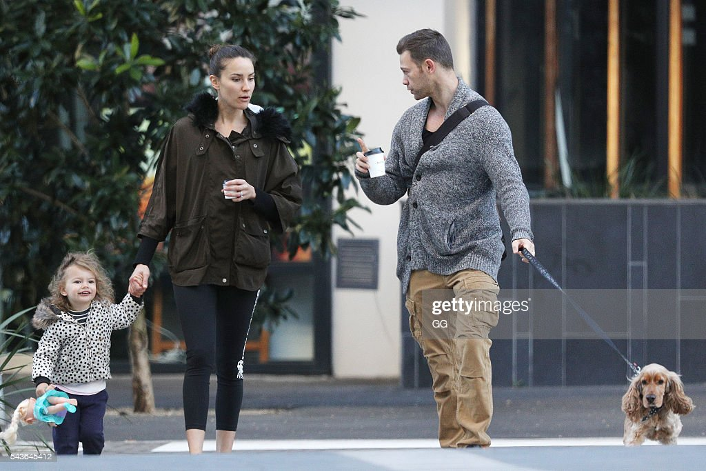 Rachael Finch and her husband Michael Mizine are seen with their daughter Violet on June 28, 2016 in Sydney, Australia.