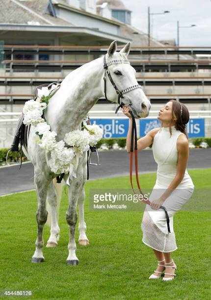 Rachael Finch poses alongside a horse at the launch of the 2014 Sydney Spring Carnival at Royal Randwick Racecourse on September 2 2014 in Sydney...