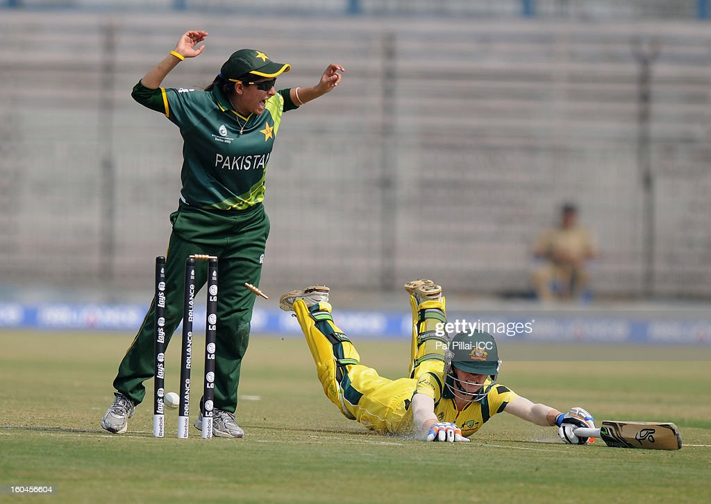 Rachael Haynes of Australia gets run out by pakistan captain Sana Mir during the second match of ICC Womens World Cup between Australia and Pakistan, played at the Barabati stadium on February 1, 2013 in Cuttack, India.
