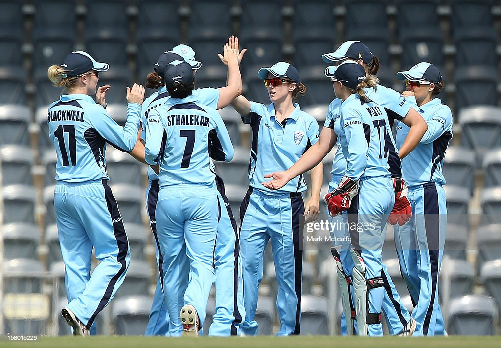 Rachael Haynes of the Breakers (C) celebrates with teammates after taking a catch to dismiss Emma Thompson of the Roar during the women's Twenty20 match between the New South Wales Breakers and the Tasmania Roar at Blacktown International Sportspark on December 9, 2012 in Sydney, Australia.