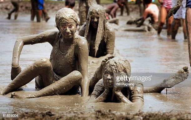 Rachael Natiw age 12 of Canton Michigan and her friend Alyssa Braun age 12 of Canton relax in a giant lake of mud at the annual Mud Day celebration...