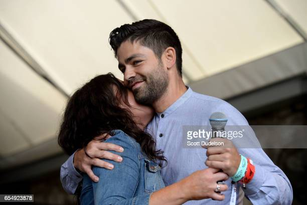 Rachael Ray and Adrian Grenier appear onstage during the Rachael Ray SXSW Feedback Party at Stubbs BBQ on March 18 2017 in Austin Texas
