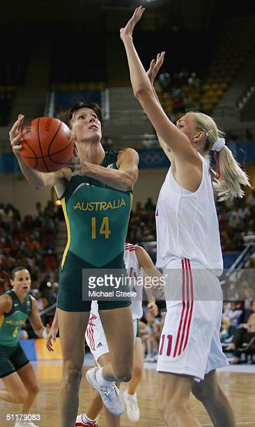 Rachael Sporn of Australia goes to the basket agaist Maria Stepanova of Russia in the women's basketball preliminary game on August 16 2004 during...