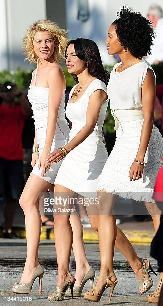 Rachael TaylorJessica Guadix and Annie Ilonzeh on the set of 'Charlies Angels' TV series on March 16 2011 in Miami Beach Florida