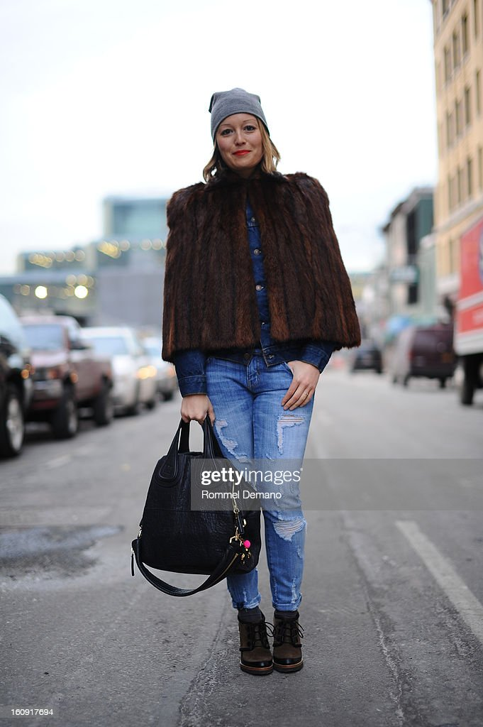 Rachael Wang, Editor of Nylon Magazine, attends the Edun show wearing a vintage fur, Givenchy bag and Asos shoes on February 7, 2013 in New York City.