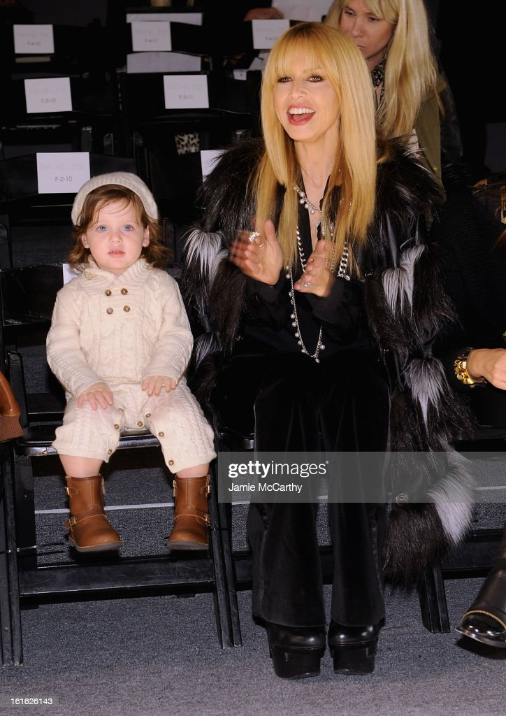Rachael Zoe with son Skyler Berman (Left) attends Rachel Zoe during Fall 2013 Mercedes-Benz Fashion Week at The Studio at Lincoln Center on February 13, 2013 in New York City.