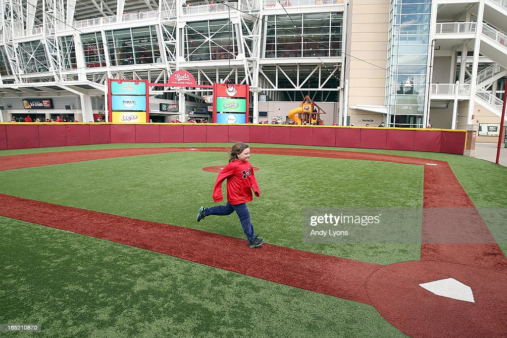 Rachel Arnold runs the bases on a baseball diamond for children before the start of the Los Angeles Angels of Anaheim game against the Cincinnati Reds at Great American Ball Park on April 1, 2013 in Cincinnati, Ohio.