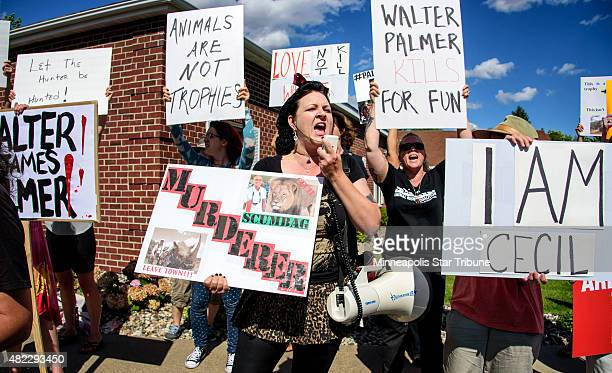 Rachel Augusta leads a group of protestors from Animal Rights Coalition and Minnesota Animal Liberation in front of the dental practice River Bluff...