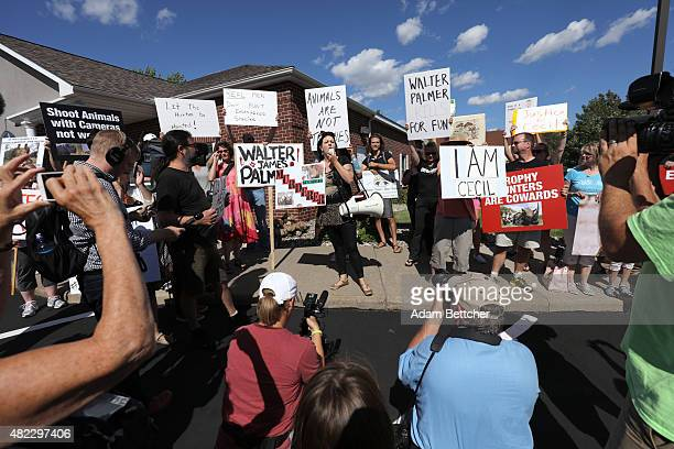 Rachel Augusta leads the protest of the killing of Cecil the lion in the parking lot of hunter Dr Walter Palmer's River Bluff Dental Clinic on July...