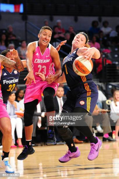 Rachel Banham of the Connecticut Sun handles the ball against Layshia Clarendon of the Atlanta Dream during at WNBA game on August 15 2017 at Hank...