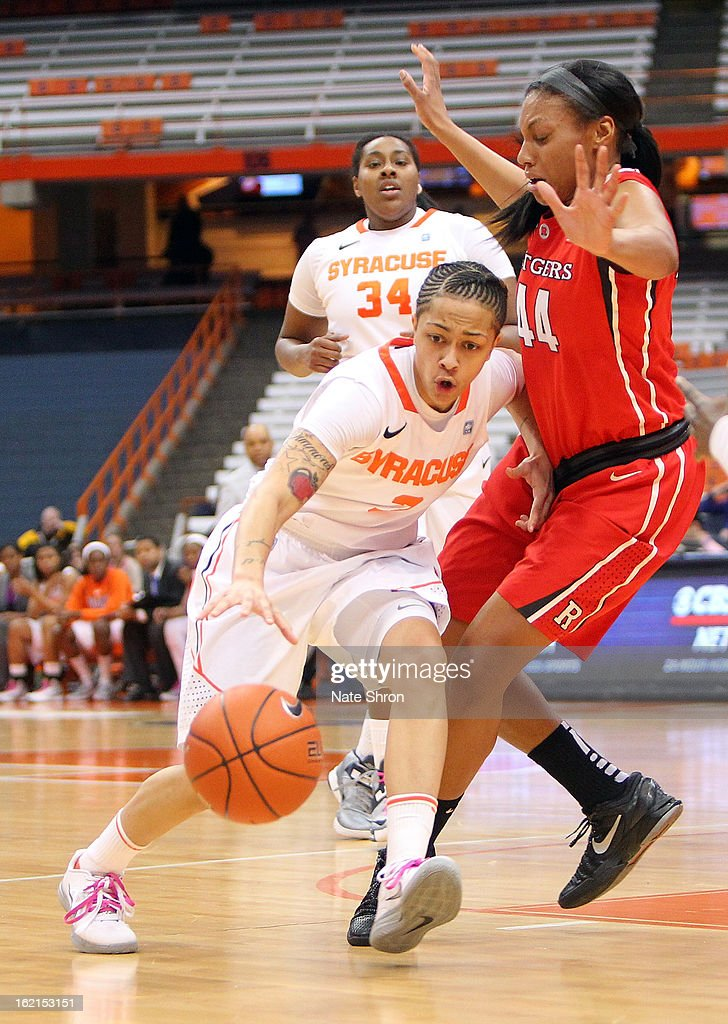 Rachel Coffey #3 of the Syracuse Orange drives to the basket against Betnijah Laney #44 of the Rutgers Scarlet Knights during the game at the Carrier Dome on February 19, 2013 in Syracuse, New York.
