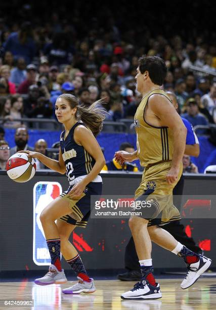 Rachel DeMita drives against Owner Mark Cuban of the Dallas Mavericks during the NBA AllStar Celebrity Game at the MercedesBenz Superdome on February...