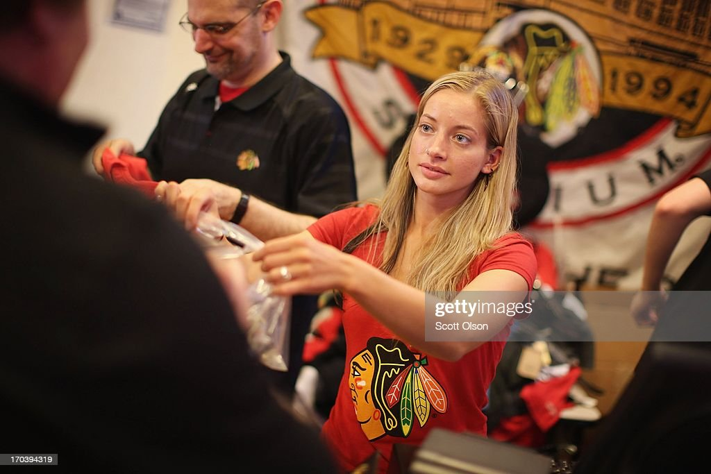 Rachel Dettloff rings up merchadise for a customer at the Blackhawks Store on Michigan Avenue in the Loop on June 12, 2013 in Chicago, Illinois. The Chicago Blackhawks will match up against the Boston Bruins tonight at the United Center in the first game on the NHL Stanley Cup playoffs.
