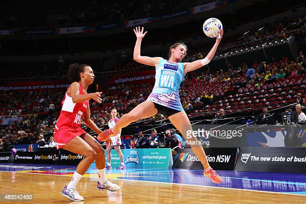Rachel Forbes of Scotland is challenged by Serena Guthrie of England during the 2015 Netball World Cup match between England and Scotland at...
