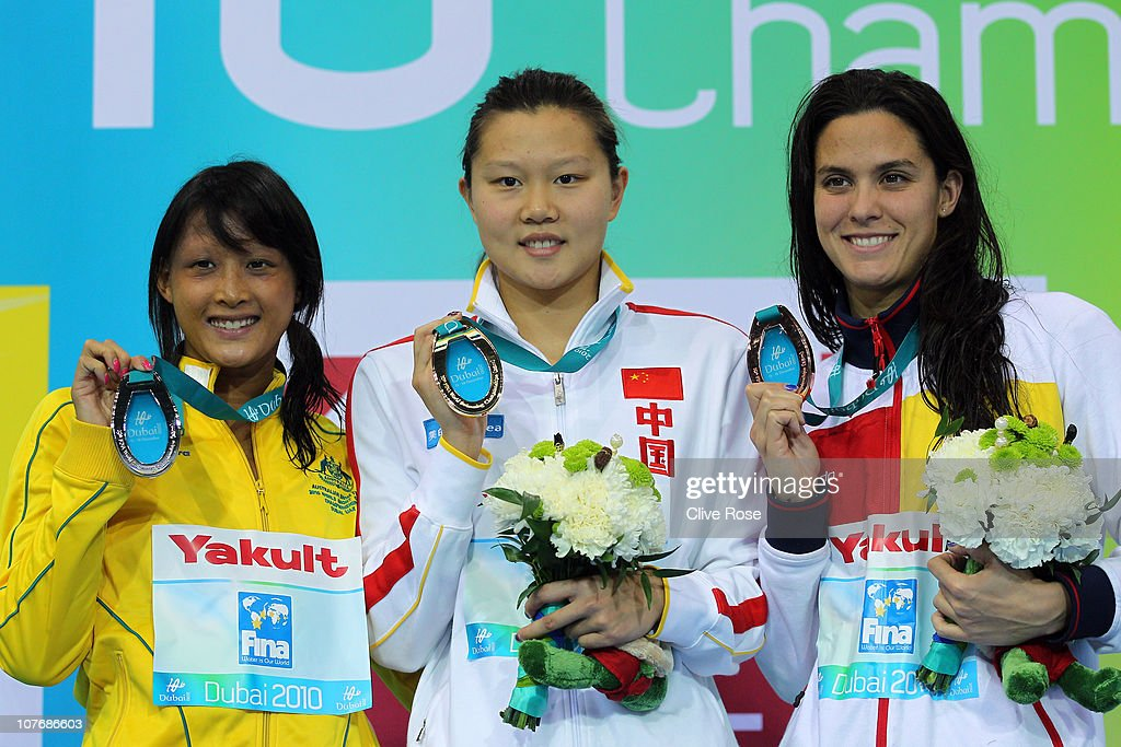 Rachel Goh of Australia (L), Jing Zhao of China and Mercedes Peris Minguet of Spain (R) pose with their medals after the Women's 50m Backstroke final on day five of the 10th FINA World Swimming Championships (25m) at the Hamdan bin Mohammed bin Rashid Sports Complex on December 19, 2010 in Dubai, United Arab Emirates.