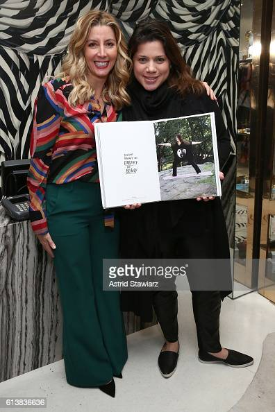 Rachel Goldstein and Sara Blakely pose for a photo together as Sara Blakely and Alice Olivia celebrate the launch of 'The Belly Art Project' on...