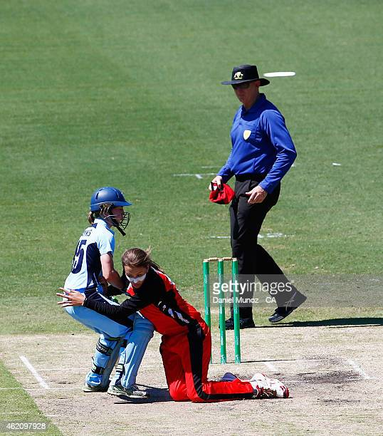 Rachel Haynes of the Breakers and Alex Price of the Scorpions collide during the WNCL Final match between South Australia and New South Wales at...
