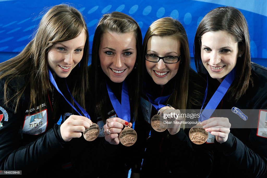 Rachel Homan, Emma Miskew, Alison Kreviazuk and Lisa Weagle of Canada pose with the their medals after winning the bronze medal on Day 9 of the Titlis Glacier Mountain World Women's Curling Championship at the Volvo Sports Centre on March 24, 2013 in Riga, Latvia.