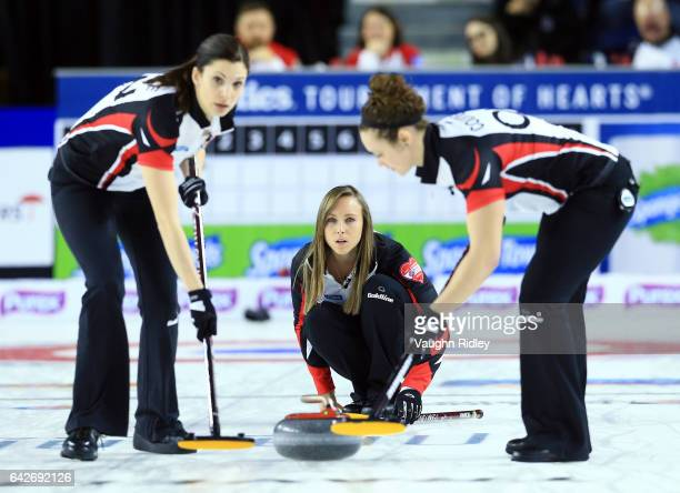 Rachel Homan of Ontario delivers a stone as Lisa Weagle and Joanne Courtney sweep in a draw one match against Ontario during the 2017 Scotties...