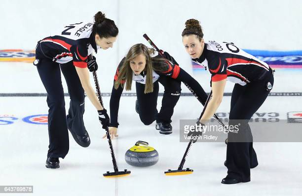 Rachel Homan of Ontario delivers a stone as Lisa Weagle and Joanne Courtney sweep in a draw eleven match against Newfoundland Labrador during the...
