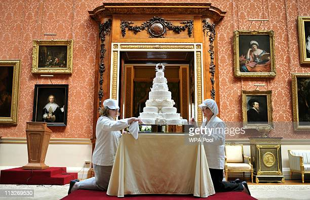 Rachel Jane Eardley and Diane Pallett put the finishing touches to the Royal Wedding cake that Fiona Cairns and her team at Fiona Cairns Ltd of...