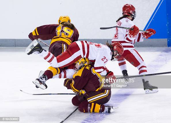 Rachel Jones of the Wisconsin Badgers collides with Milica McMillen and Kelly Pannek both of the Minnesota Golden Gophers during game two of the 2016...