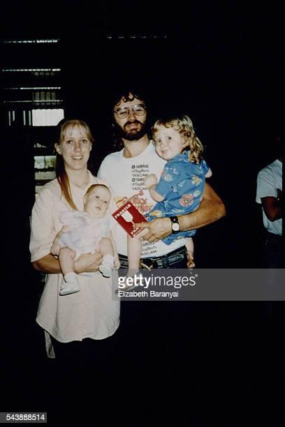 Rachel Koresh holds daughter Star and her husband David holds son Cyrus | Location Honolulu International Airport HNL Hawaii USA
