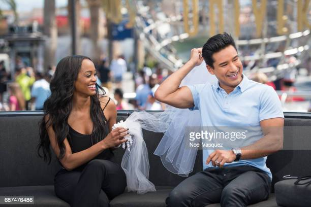 Rachel Lindsay and Mario Lopez try on different wedding veils at 'Extra' at Universal Studios Hollywood on May 23 2017 in Universal City California