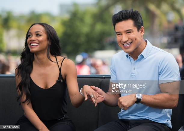Rachel Lindsay shows off her ring with Mario Lopez at Universal Studios Hollywood on May 23 2017 in Universal City California