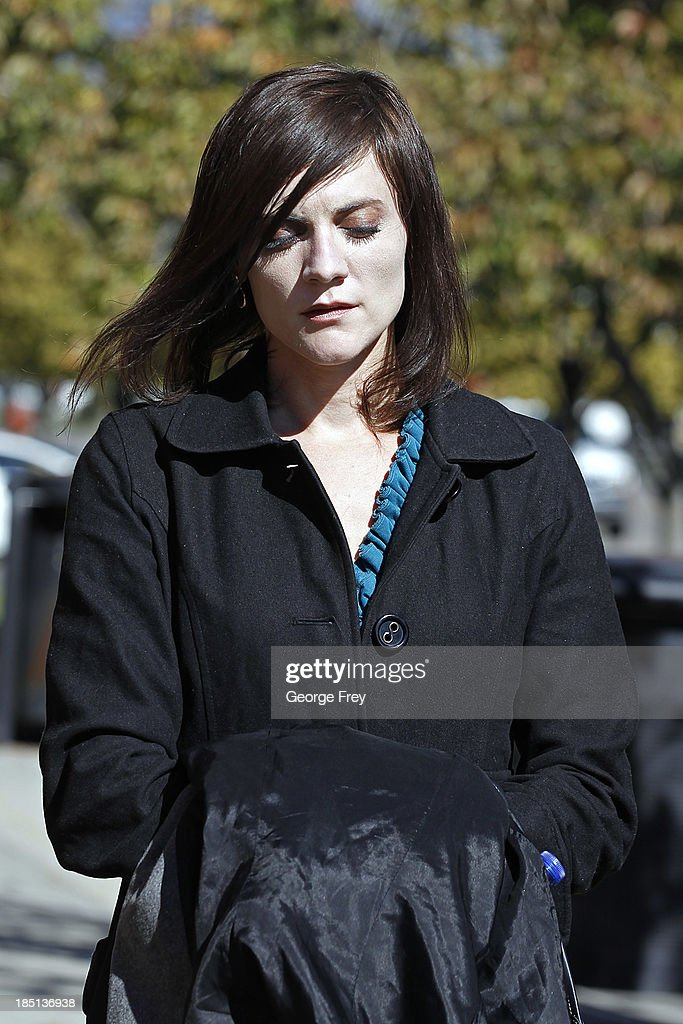 Rachel MacNeill, daughter of Martin and Michele MacNeill, walks outside the courthouse for a lunch break during her father's trial, which began today on October 17, 2013 in Provo, Utah. Dr. Martin MacNeill is accused of killing his wife Michele MacNeill in 2007 to continue an affair with a younger woman.