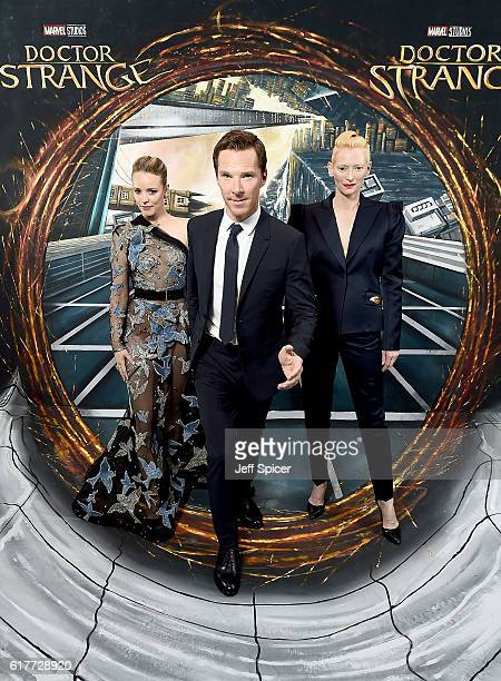 Rachel McAdams Benedict Cumberbatch and Tilda Swinton in front of the Doctor Strange inspired 3D Art at a fan screening to celebrate the release of...