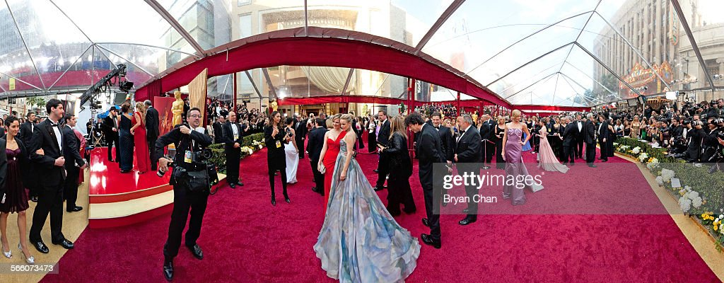 Rachel McAdams bluish dress Charlize Theron purple dress and Anna Kendrick behind Theron arrives at the 82nd Annual Academy Awards at the Kodak...