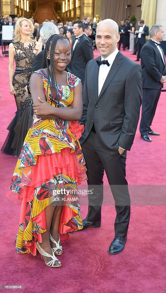 Rachel Mwanza star of the Best Foreign Language Film nominee War Witch and director Kim Nguyen arrive on the red carpet for the 85th Annual Academy...