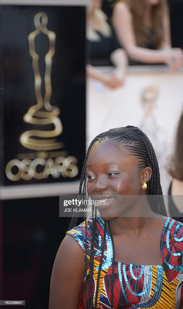Rachel Mwanza, star of the Oscar nominated Best Foreign Language Film War Witch, arrives on the red carpet for the 85th Annual Academy Awards on February 24, 2013 in Hollywood, California.