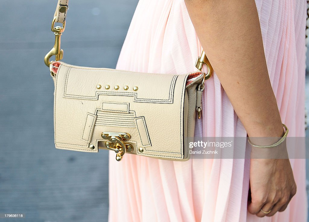 Rachel Nguyen(purse detail) is seen outside the Fashion Palette show with a Candela purse on September 5, 2013 in New York City.