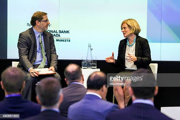 Rachel Notley Alberta's premier right speaks during an interview at the Canadian Fixed Income Conference in New York US on Wednesday Sept 30 2015...