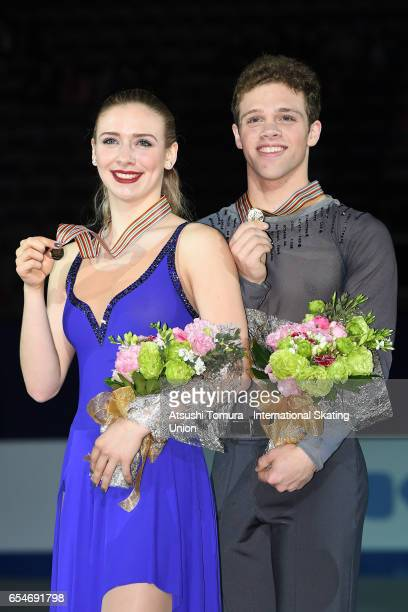 Rachel Parsons and Michael Parsons of the USA pose with their gold medals during the 4th day of the World Junior Figure Skating Championships at...