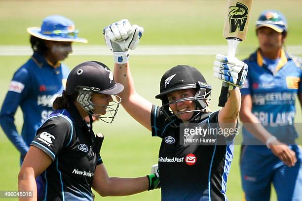 Rachel Priest celebrates her century with Suzie Bates both of New Zealand during the Third Women's One Day International match between New Zealand...