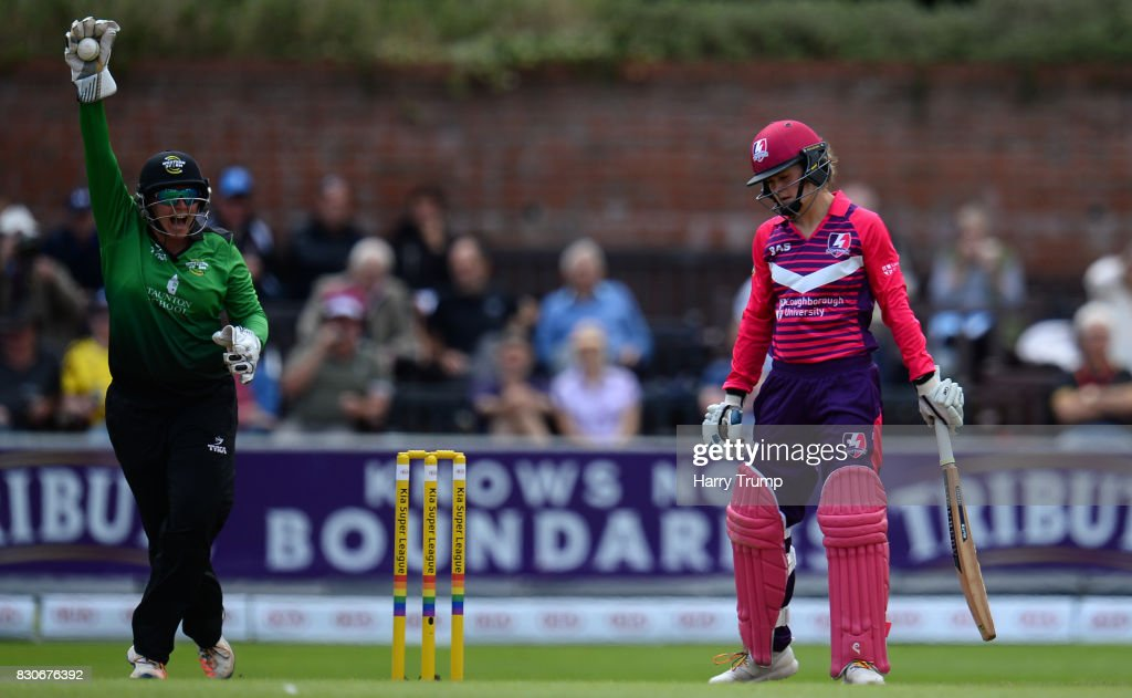 Rachel Priest of Western Storm(L) celebrates after catching Paige Scholfield of Loughborough Lightning during the Kia Super League 2017 match between Western Storm and Loughborough Lightning at The Cooper Associates County Ground on August 12, 2017 in Taunton, England.