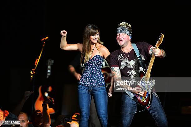 Rachel Reinert and Mike Gossin of Gloriana perform at Cruzan Amphitheatre on September 13 2014 in West Palm Beach Florida