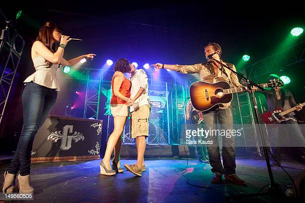 Rachel Reinert fans Tom Gossin and Mike Gossin of Gloriana perform onstage at Pepsi/Billboard's Summer Beats concert at Cannery Ballroom on July 30...