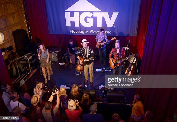 Rachel Reinert Mike Gossin and Tom Gossin of Gloriana perform at HGTVs The Lodge at CMA Music Fest 2014 in on June 8 2014 in Nashville Tennessee