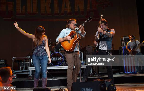 Rachel Reinert Mike Gossin and Tom Gossin of Gloriana perform in concert at Tinley Park on June 14 2014 in Chicago Illinois