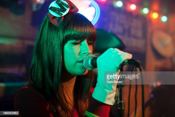 Rachel Reinert performs at the TJ Martell Foundation's Battle for the Bones for the Linds Sarcoma Fund at Losers Bar Grill on October 31 2013 in...