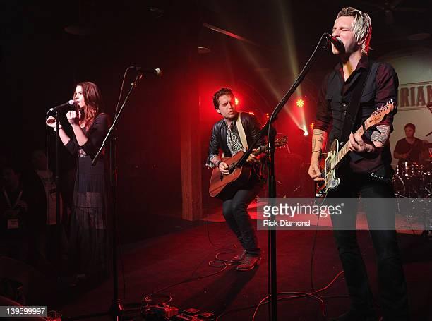 Rachel Reinert Tom Gossin and Mike Gossin of Gloriana perform during Warner Music Nashville's Warner Wednesday at aVenue on February 22 2012 in...