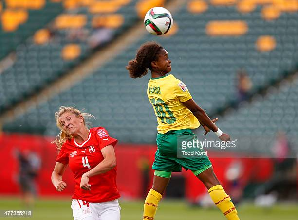 Rachel Rinast of Switzerland reacts as Jeannette Yango of Cameroon heads the ball during the FIFA Women's World Cup Canada Group C match between...