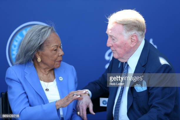 Rachel Robinson and Vin Scully share a warm moment at the unveiling of the Jackie Robinson statue before the game between the Arizona Diamondbacks...