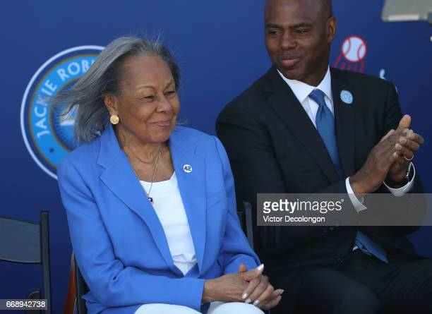 Rachel Robinson is applauded by Kevin Frazier onstage during the Los Angeles Dodgers Jackie Robinson statue unveiling at Dodger Stadium on April 15...