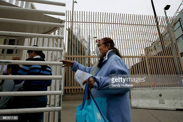 Rachel Rodriguez walks towards the United StatesMexico border while wearing a surgical mask at the Port of Entry on April 27 2009 in Tijuana Mexico...